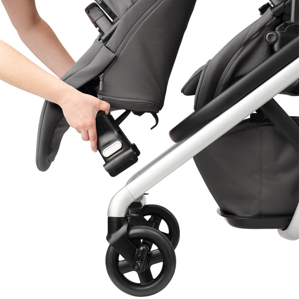 Simply slide the Maxi-Cosi Lila baby pram second child seat on the front of the stroller frame